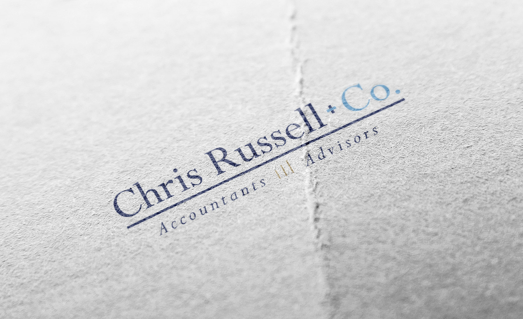 Chris Russell + Co. Logo Mockup on paper by digital marketing agency Beson4 in Jacksonville, Florida